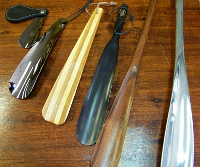 Shoe horns, wooden and metal